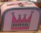 Rosa med krona och kantband
